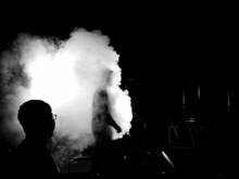 Grayscale Photo Of Two Men Surrounded By Smoke