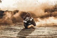 Man Riding An Atv On Brown Sand