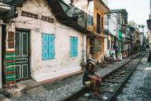 Man Sitting On Train Rail