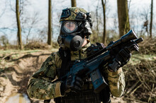 Multiple ValuArmed Soldier In Cropat Pattern Uniform Wearing M95 Gas Mask And Assault Rifle HK G36.es