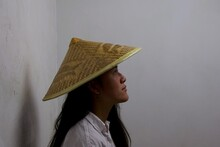 Portrait Of Woman Wearing Asian Conical Hat