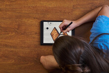 Woman Drawing Table On Tablet