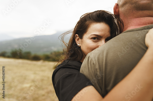 Stampa su Tela Happy couple in love hugging smiling and having fun in the mountains