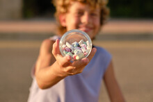 Child With Pile Of Chalks In Jar