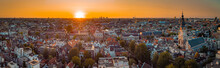 Beautiful Evening Panorama Of Amstedam City Looking Towards The West With Beautiful Sunset And Sun Setting Down Over Amsterdam. Drone View.