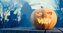 Halloween Pumpkin Glowing On Gothic Graveyard.