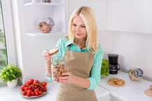 Photo Of Curious Housewife Lady Hold Open Bottle Glass Jar Macaroni Prepare Cook Meal Wear Apron Kitchen Room Indoors