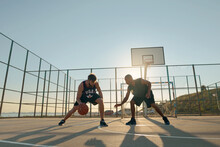 Young Sportsmen Playing Basketball On Sports Court