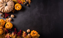 Autumn Composition. Pumpkin, Cotton Flowers And Autumn Leaves On Dark Stone Background. Flat Lay, Top View With Copy Space