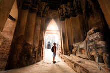 Tourist Male Shoulder Bag Walking Near Ancient Ruined Stupa With Photo Camera In Ayutthaya