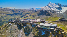 Amazing Aerial View Of Grossglockner Mountain Peaks Covered By Snow In Summer Season. Drone Viewpoint Over Edelweiss Spitze.