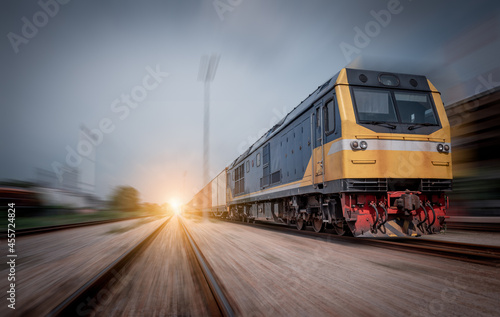 Fototapeta Train with container cargo boxes at railway station transport logistic distribution goods is industry business concept