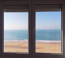 Close Glass Window Viewing Blue Sea In Cádiz, Andalucía, Spain