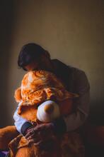 Man Holding An Orange Teddy Bear Indoor