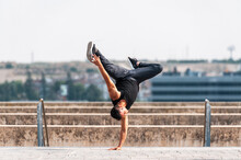 Break Dancer Performing A Hand Stand In Park