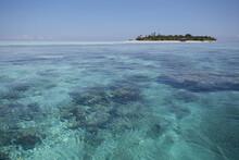 Clear Blue Water Washing Tropical Island