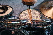 Drum Kit With Drum Sticks And Headphones