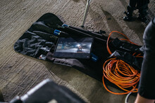 Video And Lighting Equipment Displayed In Their Cases On Concrete Floor