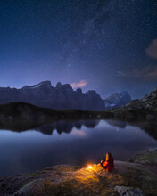 Girl Sitting At The Lake Watching The Night Sky