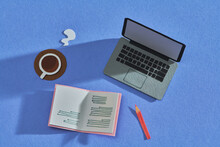 Notebook, Pencill, Cup Of Coffee And Laptop On A Desk