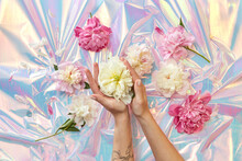 Woman Holding Peonies At Holographic Foil