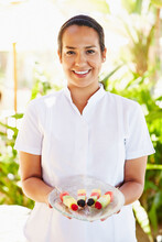 Portrait Of Staff Service Person Holding Fruit Skewers