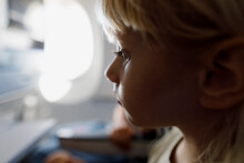 A Little Girl Watching Video In An Airplane