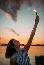 Girl With Fireworks At Sunset