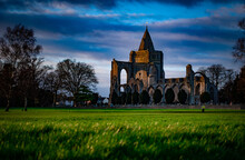 Crowland Abbey, Lincolnshire, UK From Snowden Field In Low Winter Sunlight.
