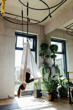 Graceful Female Hanging On Aerial Silks