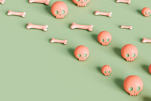 Pink Skulls And Bone On Green Background