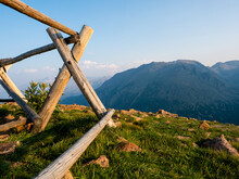 Fence Posts At The Edge Of A Cliff In The Rocky Mountains.