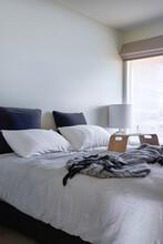 Bedroom With Muted Tones Of Grey Linen