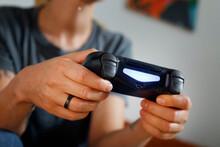 Crop Female Gamer With Modern Gamepad