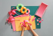Hands Cutting Paper And Making Creative Diy Crafts