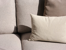 Beige Cushions On Couch.