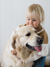 Toddler Being Affectionate With Dog