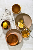 Different tableware and lemon on white background
