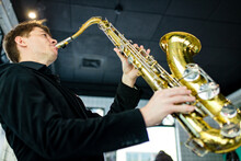 Male Jazz Musician Playing A Saxophone In A Restaurant