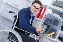 Disabled Man On Wheelchair Repairing Printer