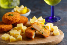 Homemade Cheese Croquettes. A Delicious Starter Homemade Cheese Croquettes With A Piece Of Lemon On The Side.