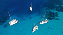 Aerial Drone Photo Of Beautiful Sail Boat Anchored In Tropical Exotic Island Bay With Turquoise Clear Sea