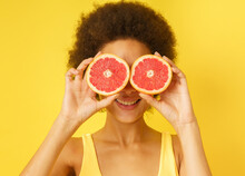 Happy Happy Girl Plays With Red Orange Slices