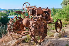 A Rusty Old Tractor Used For Tillage In The Field