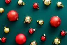 Christmas Layout With Golden And Red Baubles On Green Background. Flat Lay, Top View, Overhead. Vintage Style.