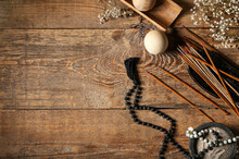 Composition With Incense Sticks And Tibetan Beads On Wooden Background
