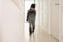 Boy Dressed Up As Batman Inside A White House