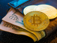 50 Dollar Bills In A Wallet, On Top Of Gold Bitcoins. Close-up, Close-up. Popular All Over The World Cryptocurrency, Bitcoins, Financial Exchange, Trading, Exchange Rates. New Financial Technologies.