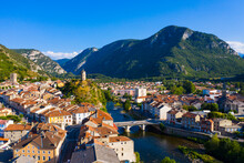 View From Drone Of Small French Town Of Tarascon-sur-Ariege On Banks Of Ariege River In Valley Of Pyrenees