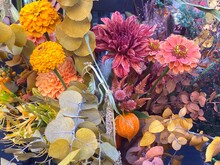 Autumn Bouquet Of Flowers Chrysanthemums, Gerberas, Zinnia, Physalis, Dry Herbs And Tree Leaves. Beautiful Autumn Flower Arrangement In Yellow-orange Colors.